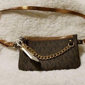 Mini wristlet with gold chain zipper